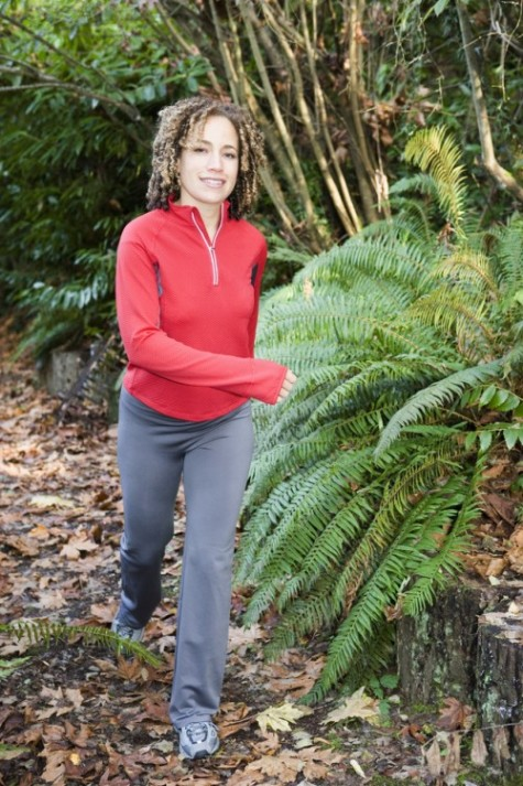 @Glowimages: Woman jogging on forest path